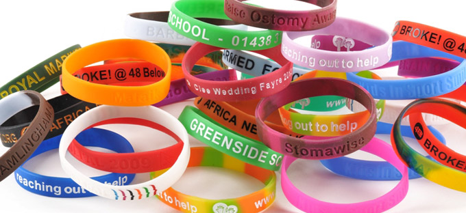 assortment of coloured and branded silicone wristbands